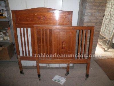 Cabezal y pies de cama antiguos por 140 euros