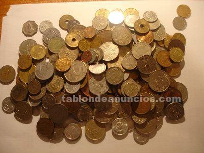 Monedas mundiales variadas al peso