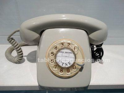 Teléfono rueda gris con números dorados