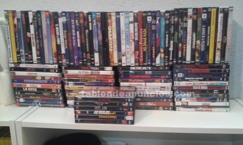 Vendo  100 dvd peliculas . Regalo pletina dvd (sin usar)