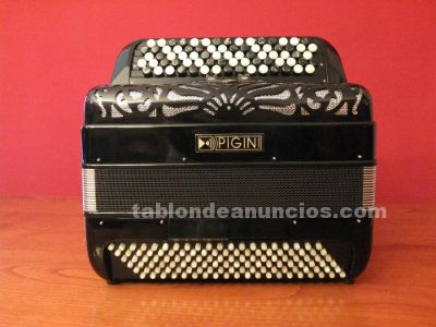 Se vende acordeon pigini