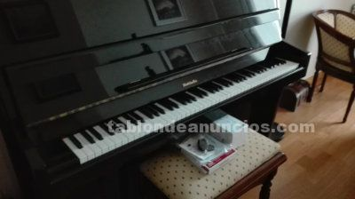 Vendo piano de pared color negro marca baldwind