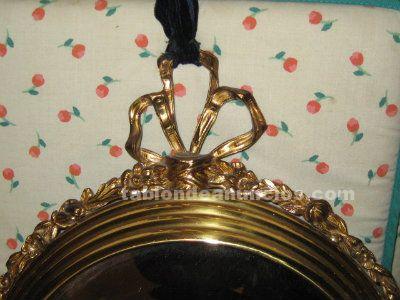 Espejo redondo de bronce y cristal