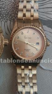 Vendo reloj dorado con circonitas