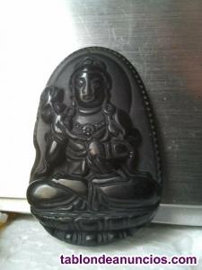 Amuleto budista tibetano cortado en obsidiana negra. Buda. Tibet. Hombre y mujer