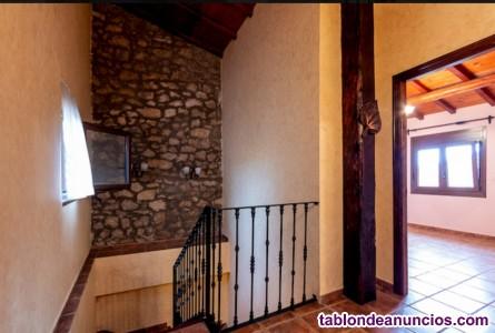 Casa adosada estilo rústico