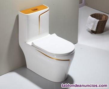 Inodoro de diseño blanco con oro