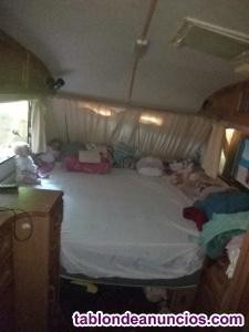 Venta de casa de madera y caravana