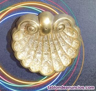 Pieza antiquísima de bronce labrada con un trabajo magistral