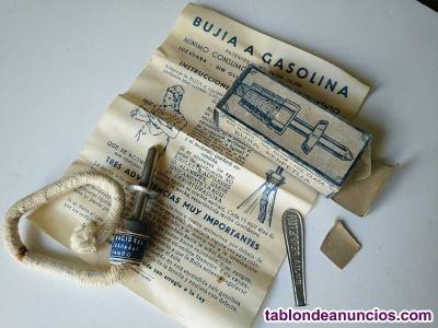 La bujia perpetua a gasolina con su caja original, hoja de instrucciones y acces