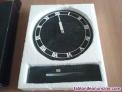 Reloj de mármol color negro con los numeros tallados sobre elmarmol y marcados e