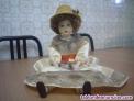 Muñeca  de cerámica cara, manos y pies, vestido color veis, se puede colocar de