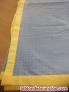 Colcha color amarilla de 1,95 mts. De ancho por 2,60 mts. De largo, con un rebor