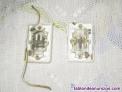 Fotos del anuncio: 2 interruptores rectangulares pequeños.