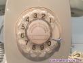 Teléfono heraldo de pared gris con números dorados
