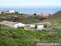 Se vende casa con terreno, 2 naves y estanques. Machado. HV3033